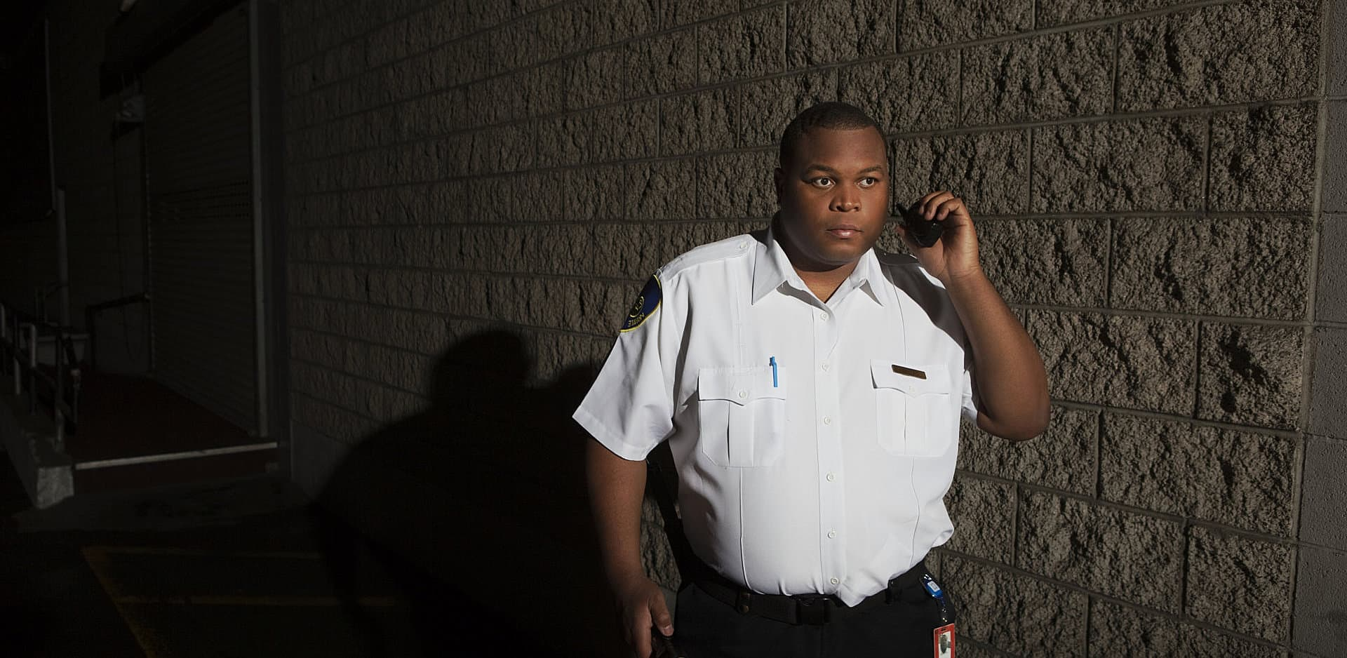 security guard holding walkie-talkie