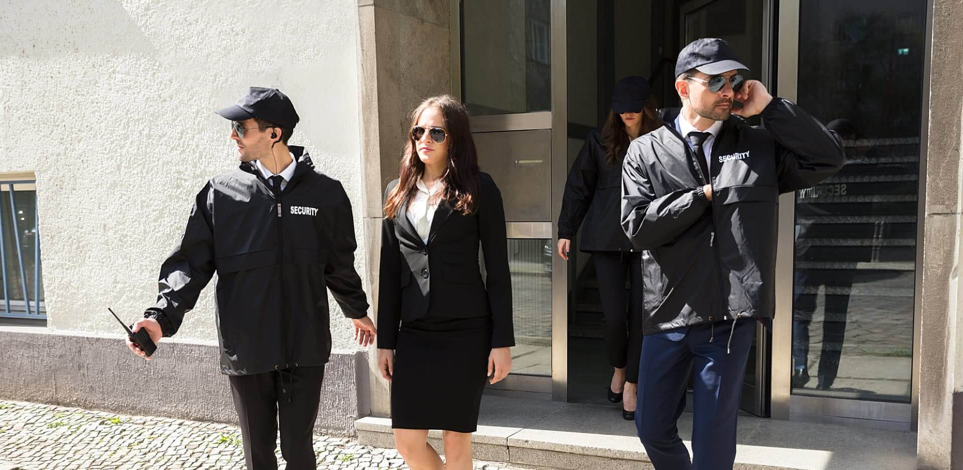 security escorting vip woman outside the building